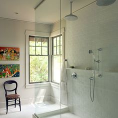 from Southern Living -- 60 Luxurious Master Baths: Multiply Shower Fixtures...Dual overhead showerheads and hand-held sprayer options are the stars of this large and luxurious shower space.
