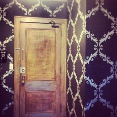 Acanthus Trellis Wall Stencil on Walls - great rustic door, too! Project by Alicia Danzig.