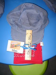 Conductor kit party favors.  Hat, whistle and bandana.  Too cute!