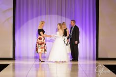 debutante greeting her parents at the Debutante Fashion Show
