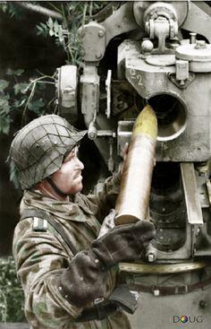 German soldier loading a shell into an cm FlaK gun France Photo: Bundesarchiv Bild Röder.
