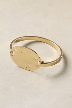 totally don't take astrology seriosuly, but this is a cool little bracelet! the dots are a star map of your sign