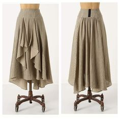 Anthro Eva Franco Windswept Prairie Skirt Straight-as-an-arrow stripes lend linear appeal to Eva Franco's breezy, graduated-hem skirt. Mild pulling  Decorative hook-and-eye at waist  Side zip  Cotton; polyester lining  Dry clean Anthropologie Skirts