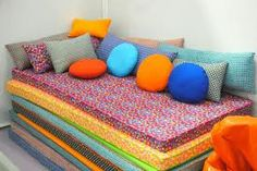 Stackable couch made of foam mats covered in cute fabric. Good for pulling apart for sleepovers or taking some for camping. Really love this idea.
