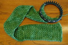 Free Mossy Scarf pattern by telaine in chunky alpaca with garter border (S=slip stitch, K=knit, P=purl):Crochet cast on 17 pegs.  Start with 8 rows of garter stitch (K row, P row)  S K K P K P K P K P K P K P K K K {}  S P P P K P K P K P K P K P P P P {} S K K K P K P K P K P K P K K K K {} S P P K P K P K P K P K P K P P P  Repeat above until desired length. End with 8 rows of garter stitch.Yarn-over bindoff for edge that closely matches stretchy crochet cast-on.