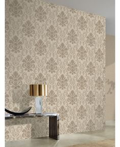 A stunning damask patterned wallpaper Features glitter and metallic elements Ideal for bedrooms and lounges