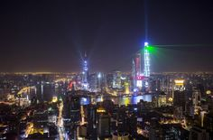 Light and laser illuminate the Lujiazui financial district of Pudong in Shanghai, China, during a light show as part of a New Year countdown celebrations on the Bund in Shanghai January 1, 2015. REUTERS/Aly Song
