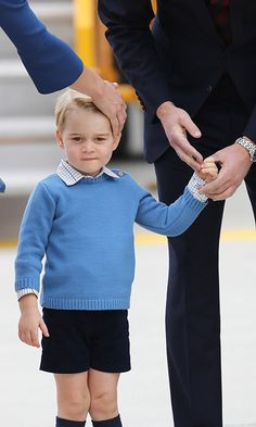 Fans were delighted to get a glimpse of three-year-old Prince George, who looked adorable in a blue sweater, checkered shirt, navy shorts and knee-high socks. <br><br>Photo: © Chris Jackson/Getty Images