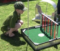 Miniature Golf for Sports parties- could you do this with corn hole boards?!