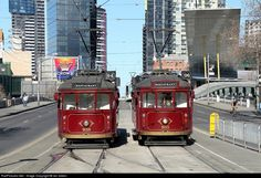 Two restaurant trams running a lunch time service pass in Clarendon Street near Flinders Street.