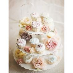 Gorgeous polymer clay miniature flowered cupcake tiered stand.