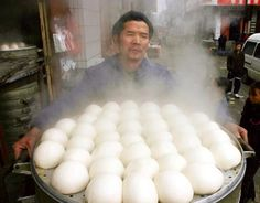 Street vendor in China - selling freshly steamed buns - delicious, simple, fluffy