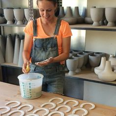 Erica cleaning up our ceramic horseshoes.