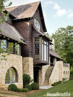 The rear façade features a staircase of Tennessee fieldstone that leads to a covered porch with an outdoor fireplace in a western North Carolina house. Click through for more of the most beautiful home exteriors and home exterior design ideas. Architecture Renovation, Residential Architecture, Architecture Details, Staircase Architecture, Mountain Living, Mountain Homes, Mountain Home Exterior, Mountain Cottage, Villa