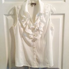 Ivory Sleeveless Ruffled Blouse Great condition, and cute top! Just haven't worn it enough and hoping someone will be able to get some enjoyment out of it.  Tahari Tops Blouses