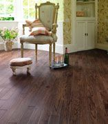 Karndean's Da Vinci Materia Dark Oak planks - a perfect blend of old & new when combined with shabby chic antique furnishings in this boudoir.  Bubbly anyone?! #flooring