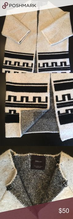 """Zara Knit Sweater Coat Cardigan Zara knit blanket coat in black and ivory Aztec/tribal/geometric print. Heavy, soft knit of acrylic, polyester, and wool. Size small but runs large (would be great for someone who usually wears a medium-large). 3/4 sleeves and on 5'7"""" frame falls to mid-thigh. Can be worn open, closed at hook-and-eye collar, or belted. From Zara AW 15 Collection. Like new, worn once. Zara Sweaters Cardigans"""