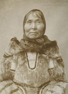 An older Labrador woman, wearing an amautik and kerchief - vintage photo from the 1920s.
