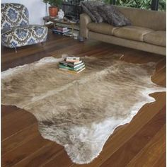 Union Rustic Modern and unique cowhide rug. Orange Area Rug, White Area Rug, Beige Area Rugs, Rustic Wooden Coffee Table, Bear Rug, Rustic Home Interiors, Cow Hide Rug, Contemporary Area Rugs, Hand Weaving