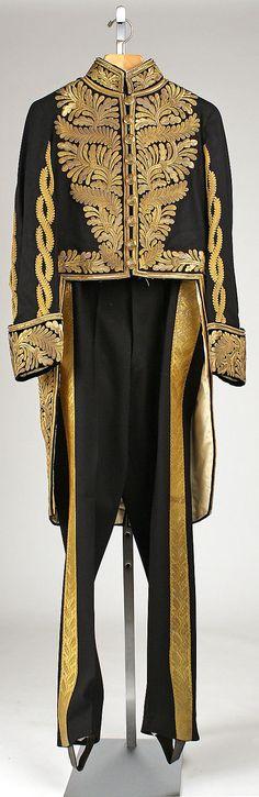 Uniform Date: 1925 Culture: British Medium: wool, metallic thread, brass, steel, silk, feathers, leather Dimensions: Length at CB (a): 43 1/4 in. (109.9 cm) Length (b): 48 1/2 in. (123.2 cm) Length (c): 29 1/2 in. (74.9 cm)