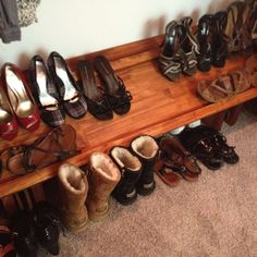 DIY Shoe rack my husband built for me.. Requires about 4 pieces of wood, a saw, liquid nails, and some stain