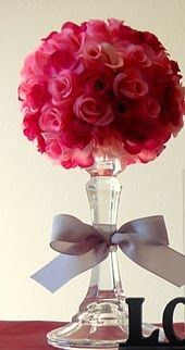 Dollar store flowers, styrofoam ball, and a candle stick. USE FOR WEDDING