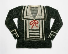 Woman's sweater | Elsa Schiaparelli | Paris, Summer 1928 | Material: hand-knitted wool | The increased interest of the couture in sports fashions designed specifically for the beach and seaside was reflected in the popularity of nautical themes in clothing, such as anchor and star embroideries, sailor collars, and flannel jackets decorated with brass buttons for summer and resort wear | Philadelphia Museum of Art