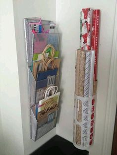 File organizer and grocery bag holder to organize gift wrap items.
