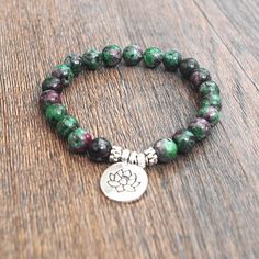 Take your shopping to the next level. How about this beauty: Handmade Zoisite ... now on sale! Get it here: http://www.divinelotustemple.com/products/handmade-zoisite-healing-stone-energy-strand-bracelet?utm_campaign=social_autopilot&utm_source=pin&utm_medium=pin