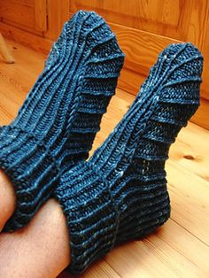 Comfy slippers to keep your toes toasty on a chilly night. A pair in size medium needs no more than a couple of hours knitting time and one skein of worsted weight yarn – the perfect pattern for those odd skeins most knitters have in stash.