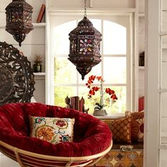 handcrafted iron lantern with colored gems and a plush papasan chair