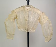 Blouse  Date: ca. 1860 Culture: American Medium: Cotton Credit Line: Brooklyn Museum Costume Collection at The Metropolitan Museum of Art, Gift of the Brooklyn Museum, 2009; Gift of Mrs. James McF. Baker, 1948