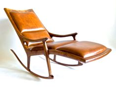 """This """"Lazy Chaise Rocker"""" made of American Black Walnut with Cherry accents running through the laminated rockers and covered in buffalo. by HennefordFineFurn on Etsy"""