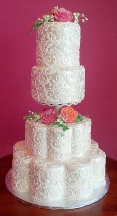 Here is one of our wedding cake options from Clarencedale Cake.  This is called Royal Scrolls.  Royal Scrolls is a traditional wedding cake with satin fondant, and detailed royal icing filigree scrollwork.  Separated in the middle, the tiers are lightly accented by gumpaste roses, hydrangeas, and ivy that match the wedding florals.