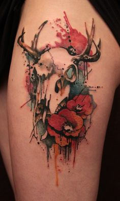 Gene Coffey tattoos symbols of life and death in this artistic watercolor tattoo of an animal skull and poppy flowers « « Ratta Tattoo