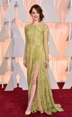 Emma Stone in a chartreuse beaded long sleeve Elie Saab gown.