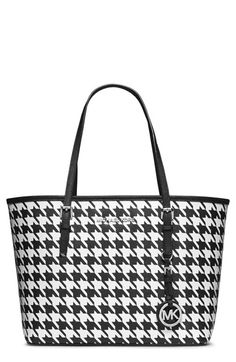 Free shipping and returns on MICHAEL Michael Kors 'Small Jet Set' Travel Tote at Nordstrom.com. Bold, houndstooth-patterned leather amplifies the everyday sophistication of a roomy, self-standing travel tote topped with belted handles and branded with a dangling silvertone logo charm.