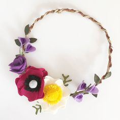 The Siobhán wreath is a one-of-a-kind beauty for your home. Each felt flower - anemone, rose, peony, and sweet pea - has been tenderly hand