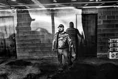"""Photographer Paolo Pellegrin won an international Photographer of the year award because of this photo but later caused much controversy because the caption was not truthful to the picture. The caption says, """"'The Crescent, Rochester USA, 2012. A former US Marine corp sniper with his weapon. Rochester, NY USA 2012."""" the problem is that the man in the photograph is not a Marine Sniper. He's a former photojournalism student. http://www.dpreview.com/news/2013/02/25/ethics-prize-wining-photo"""