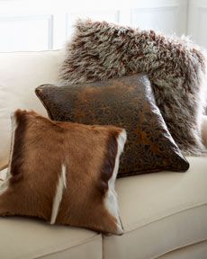 Hairhide, Leather, & Sheepskin Accent Pillows by Old Hickory Tannery at Horchow. different textured pillows