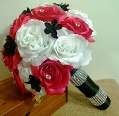 This listing is made to order and Includes 1 Bride's 10in Round Bouquet Beautiful Silk Hot Pink & White Roses with Black Accent flowers wrapped in Black Satin Ribbon with Rhinestone Wrap Embellishment