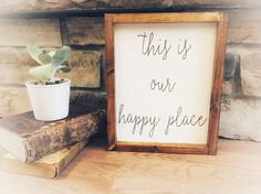 This is our happy place. Hand painted stenciled stained framed wood sign. Measures 10.75x 13 framed. ——————— All frames are stained in a provincial stain color. We offer 2 different frame styles (see photos). Please specify in order which frame you prefer. This is a MADE TO ORDER item.