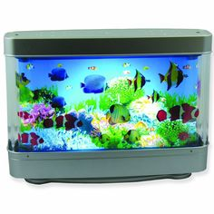 Aquarium Lamp With Fish Ocean In Motion Revolving Aquatic Scene Night Light Glow 68 yrs old, he uses this as a night light in his room:):)