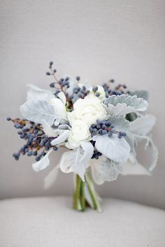 Beautiful unconventional bouquet! White, gray and blue bouquet by Stems & Styles, image by Sleepy Fox Photography. #wedding www.weddingsunveiledmagazine.com