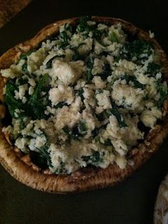 Fabulously Fit and Fearless: Stuffed Portabella Mushrooms - Left out bread crumbs. Added onion, salt, and pepper. Subbed welsh cheddar and blue cheese for the goat cheese. Used a whole container of spinach for 2 caps. So good, quick, and healthy!