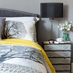 Impressive tree-design bed linen is a perfect fit with the on-trend grey of the walls.