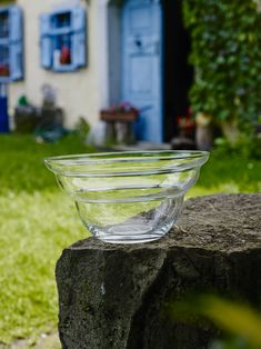 """The large """"Cotula"""" bowl has a diameter of 23 cm. The tall, hand-blown shape, brings forth to particularly good effect the dynamic lines derived from the Golden Ratio. The Cotula bowl is a real eye-catcher, even when empty. The Flower of Life in white is embossed into the bottom of the bowl. #naturesdesign #bowl #glassbowl #floweroflife #goldenratio #eyecatcher #energetize #leadfree"""