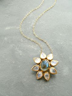 Rainbow Moonstone + Labradorite Flower Gold Necklace by KattilacGems on Etsy https://www.etsy.com/listing/228303529/rainbow-moonstone-labradorite-flower