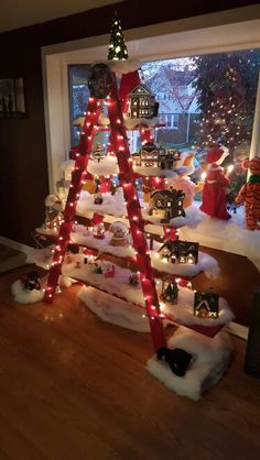 Christmas village ladder- bit ott for me this one but like the idea!