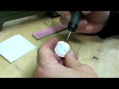 How to remove excess metal solder. She uses a silicon carbide conical grinding tip - came with her engraving kit but I'm sure you can get one by itself, too.